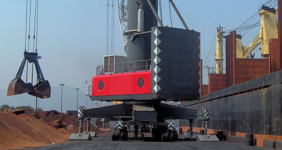 Mobile Harbour crane loading Iron ore